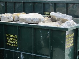 picture of a dumpster filled with misc solid waste