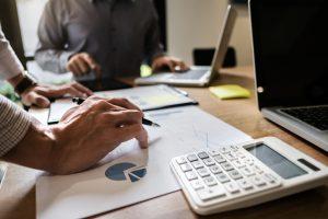 office team analyzing statistics